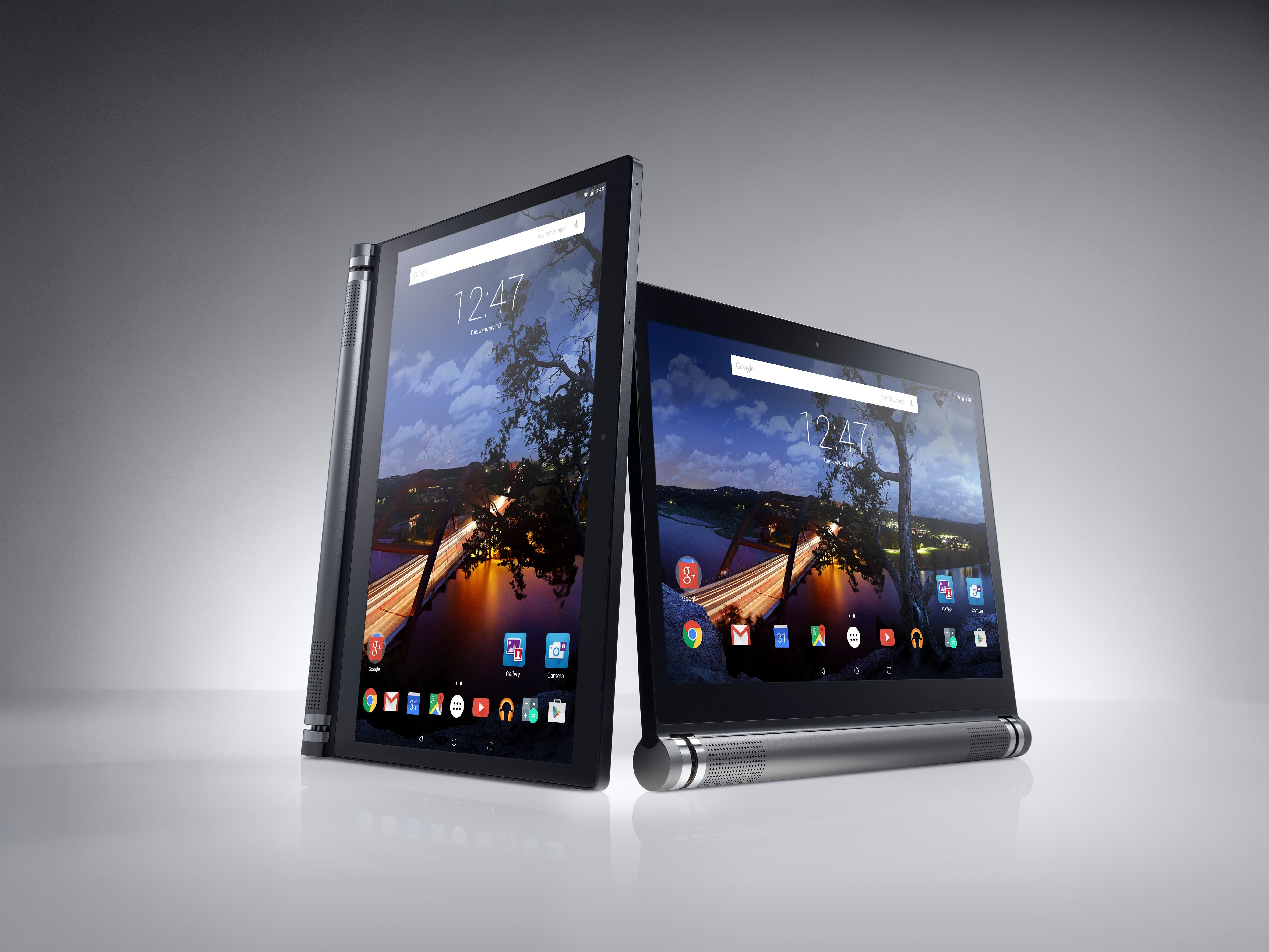 Two Dell Venue 10 7000 Series (Model 7040, codename Eagle Peak) Android tablet computers shown on a gray beauty background, one in vertical/portrait position and one in horizontal/landscape position.