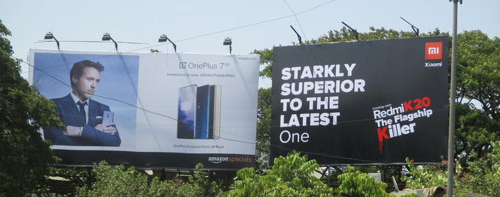 Xiaomi turns OnePlus's 'Flagship Killer' slogan against it... right next to a OnePlus billboard