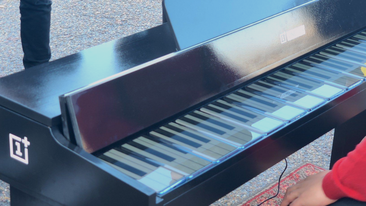 OnePlus built a piano out of 17 7T Pros and let people (and dogs) play it